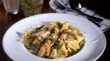 Pappardelle in olive oil, garlic, chicken breast, peas and Parmigiano